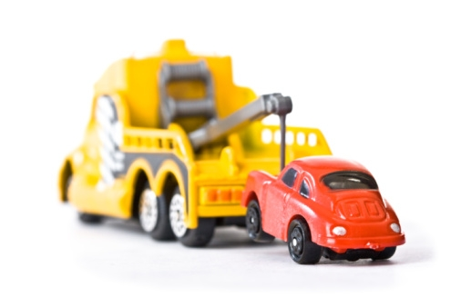 A toy car being towed
