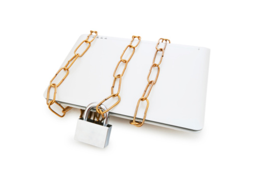 picture of laptop in chains