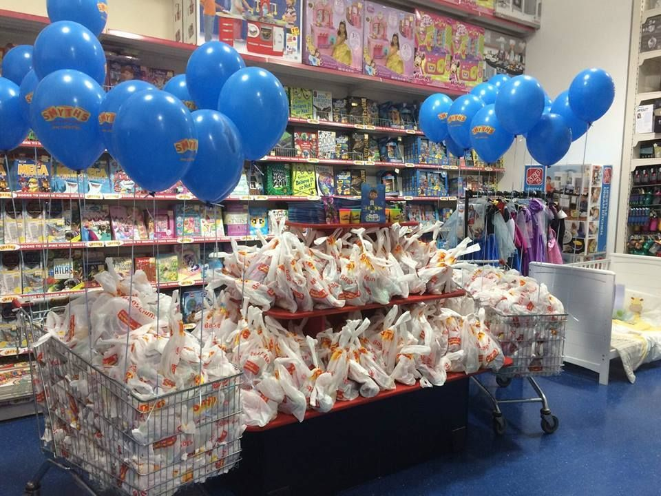 Free goodie bags piled up at a previous Smyths Toys event.